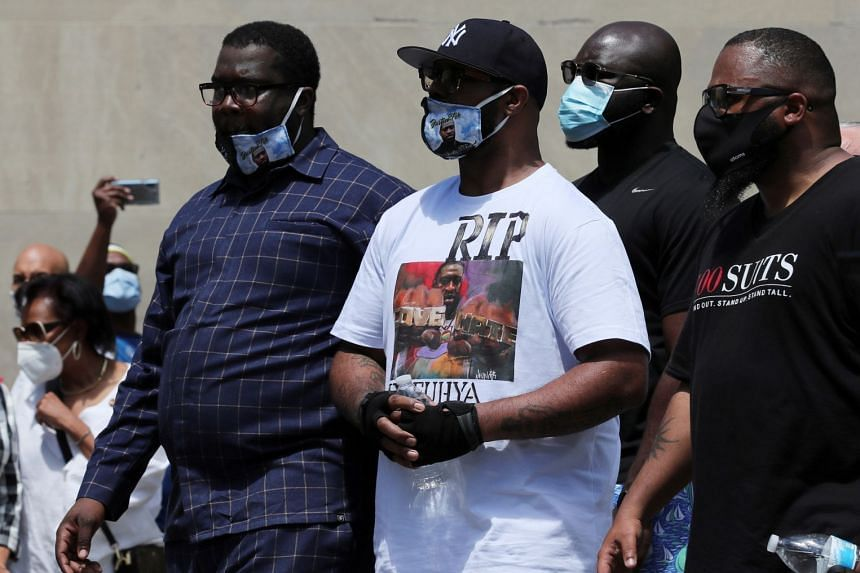 Terrence Floyd (centre), George Floyd's brother, attends the  public memorial.