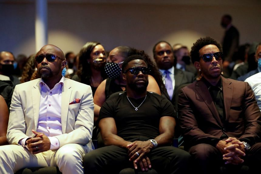 Actor Kevin Hart and musician Ludacris are seen during a memorial service for George Floyd.