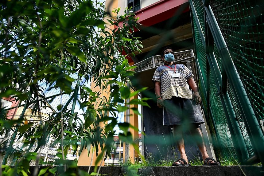 A migrant worker at the former site of Bedok North Secondary School in Jalan Damai yesterday. The site is among those being used to house healthy workers in a bid to curb Covid-19 transmission in dormitories. ST PHOTO: LIM YAOHUI