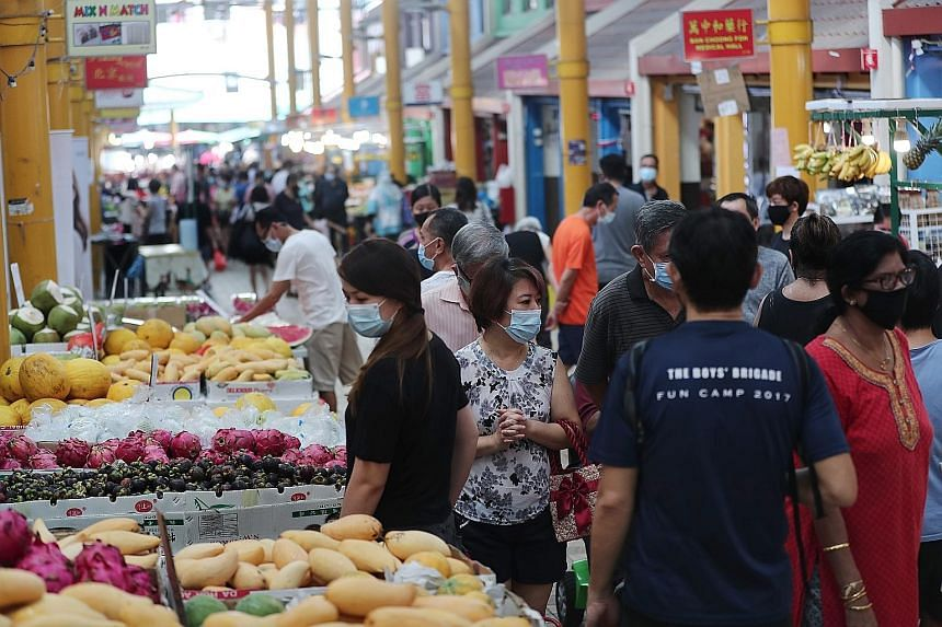 People at a market in Bukit Panjang Ring Road on Tuesday. With the June payout, the total sum given out to Singaporeans, under the Care and Support Package and the Solidarity Payment this year, reaches $3.5 billion.