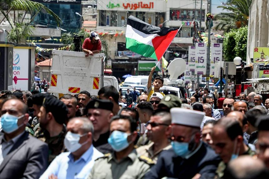 Demonstrators waved Palestinian flags and chanted slogans against Israeli settlements and the plans.