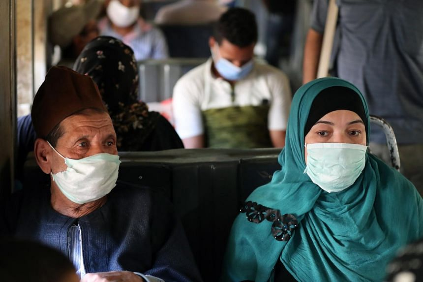 People wear masks inside a train in Cairo, Egypt, on May 31, 2020.