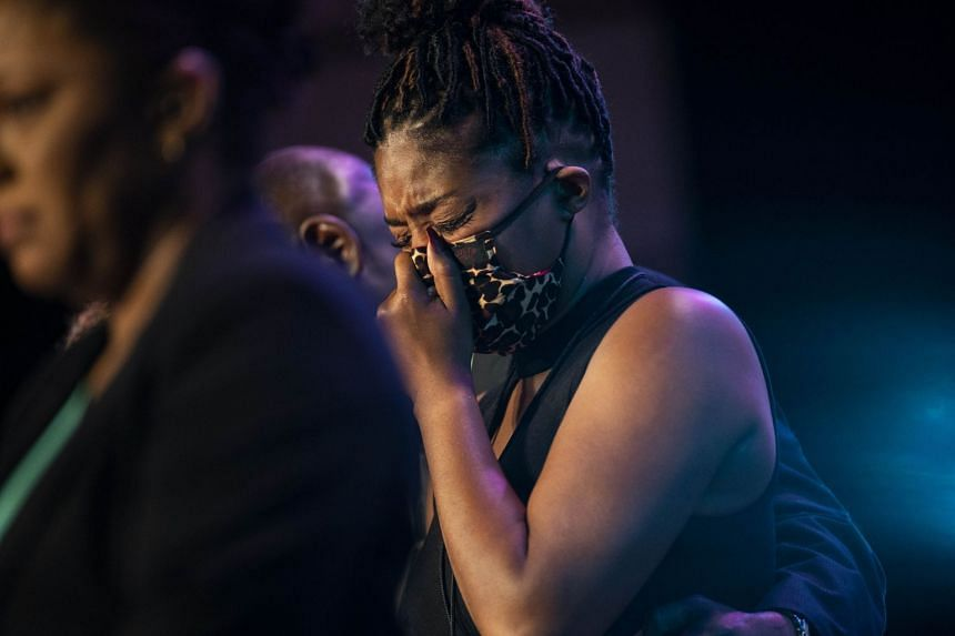Actress Tiffany Haddish cries as those at the service pause silently for eight minutes and 46 seconds.