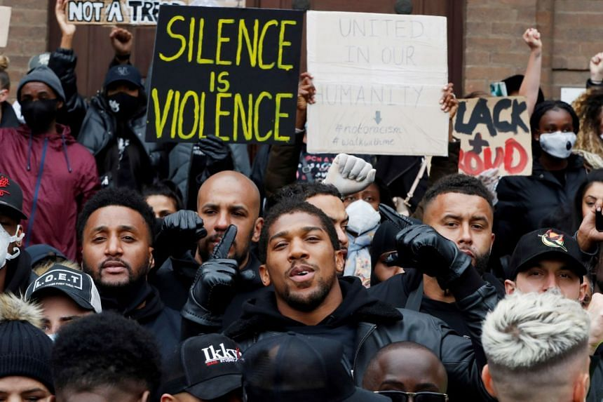Boxer Anthony Joshua is seen with protestors during a Black Lives Matter protest in Watford, Britain.