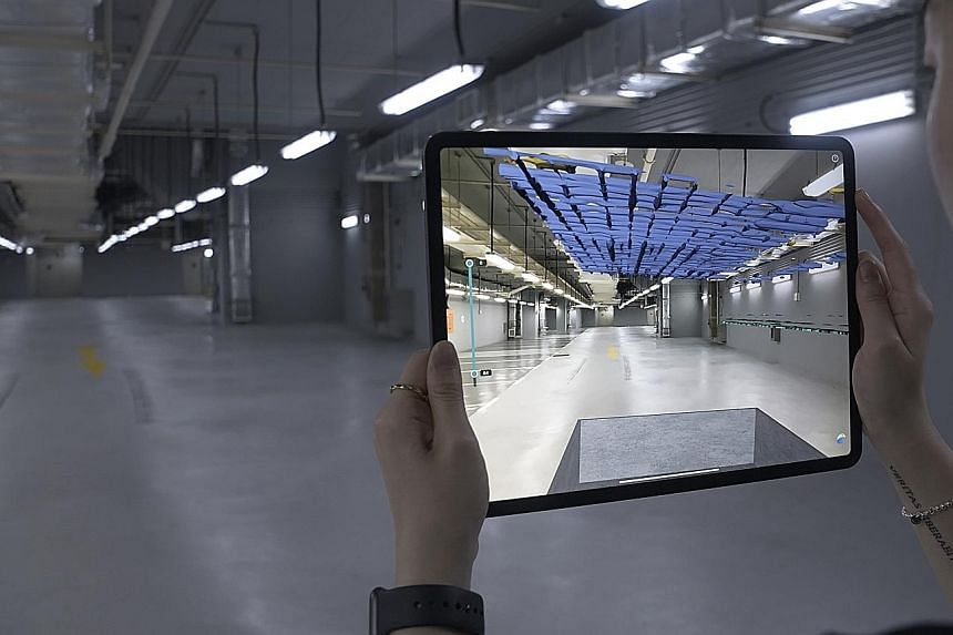 """Singapore-based inspection technology firm Screening Eagle Dreamlab's apps combine augmented reality with radar- and ultrasonic-wave technology to """"see through"""" concrete and create 3D digital models of the site (above)."""