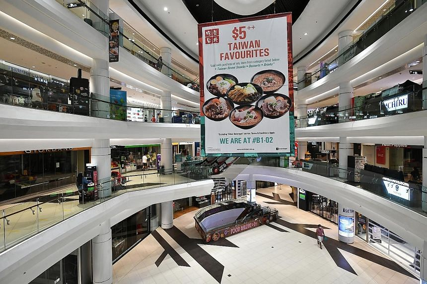 An almost empty Tampines Mall on May 12. April's drop in retail sales was much steeper than the 13.3 per cent decline in March. Circuit breaker measures, which started on April 7 and partly ended on Monday, forced all non-essential businesses to close, in