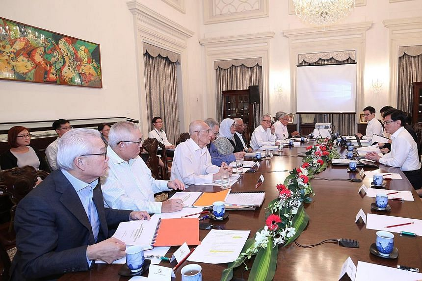 Deputy Prime Minister Heng Swee Keat and officials from the Ministry of Finance briefing President Halimah Yacob and members of the Council of Presidential Advisers in December on expected returns on the reserves. Mr Heng said the President is entitl