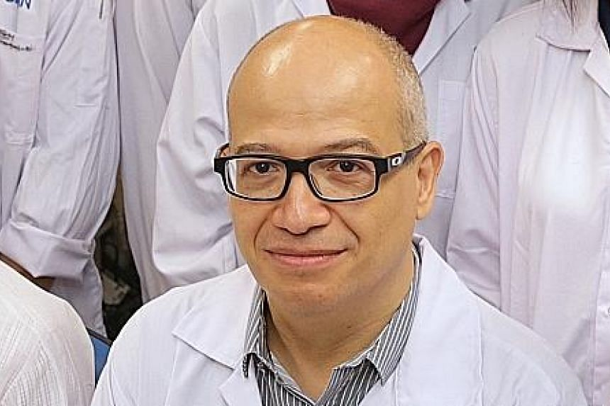 (Top) Dr Benjamin Seet is group chief research officer for the National Healthcare Group while Professor Laurent Renia (above) is executive director of the Singapore Immunology Network at the Agency for Science, Technology and Research. Both are memb