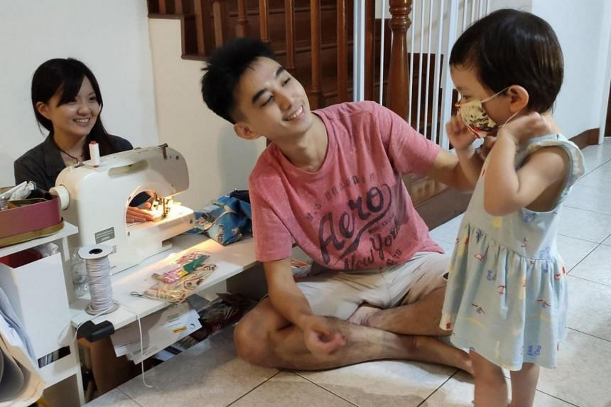 Tracy Tan (left) and Lim Hao (centre) started an initiative to sew child-size masks for needy families after dealing with the problem of finding well-fitting masks for their daughter Mira Lim.