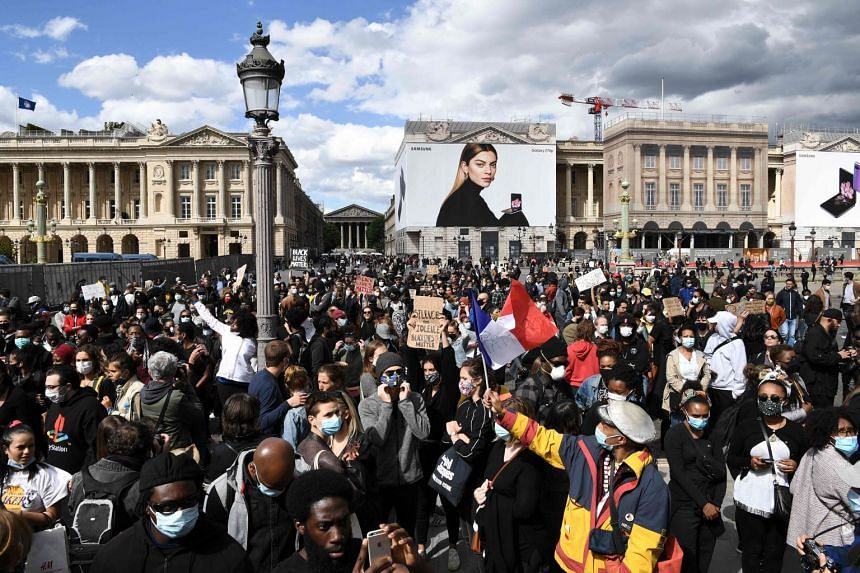 People gather near the US embassy compound in Paris, as part of Black Lives Matter protests worldwide.