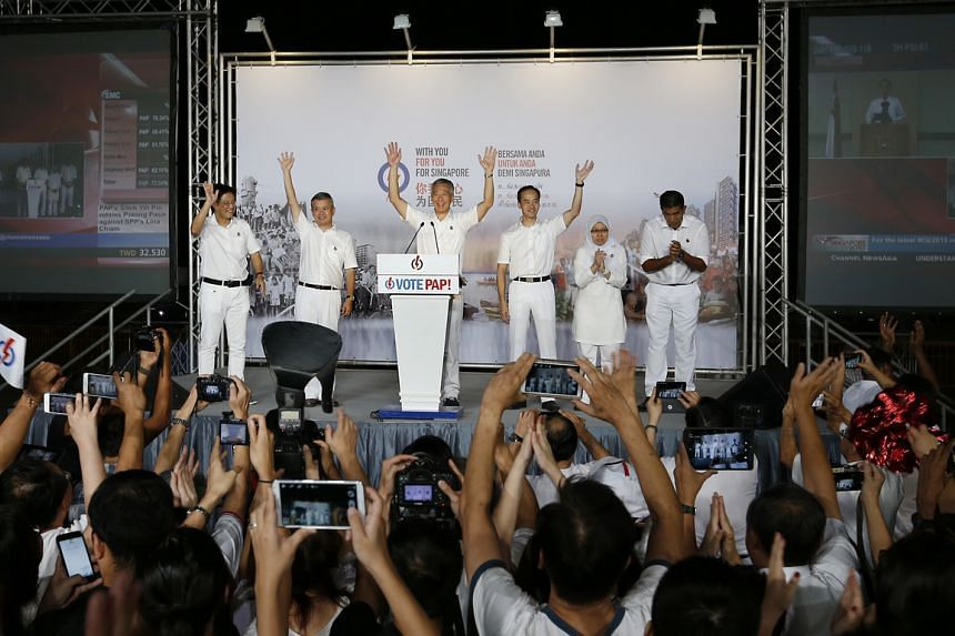 Prime Minister Lee Hsien Loong and his Ang Mo Kio GRC team thanking their supporters at Toa Payoh Stadium after election results were announced on Polling Day in September.