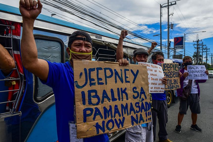 Jeepney drivers chanting slogans during a protest in Quezon city in the Metro Manila area on Monday, calling on the government to allow them to return to work. PHOTO: AGENCE FRANCE-PRESSE