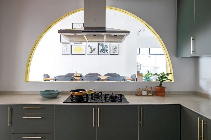 A wall was removed to create an alcove that allows the hosts to maintain visual contact with guests in the dining area while cooking in the kitchen.