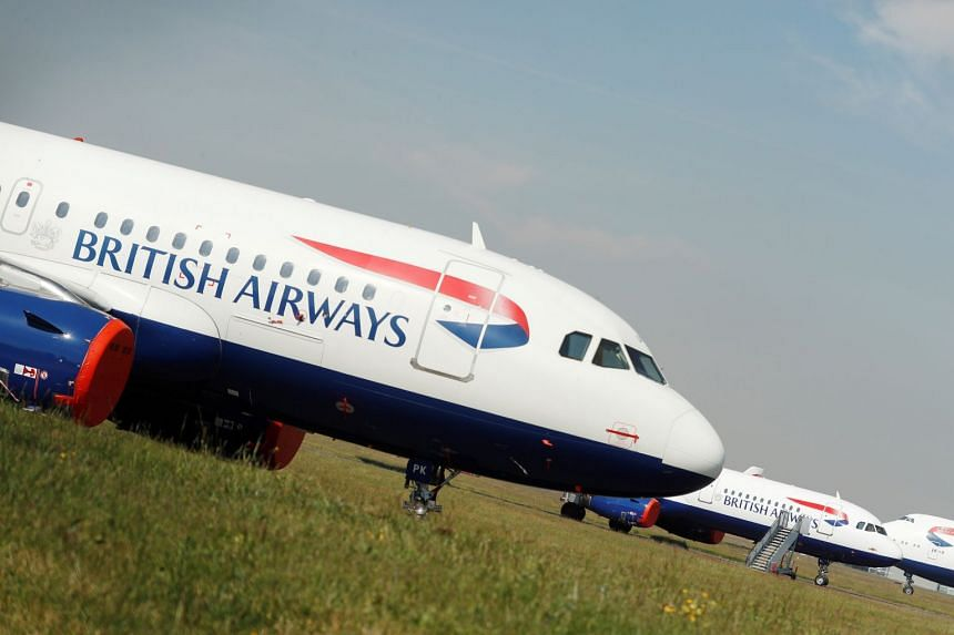 British Airways aircraft are seen at an airport in Britain.