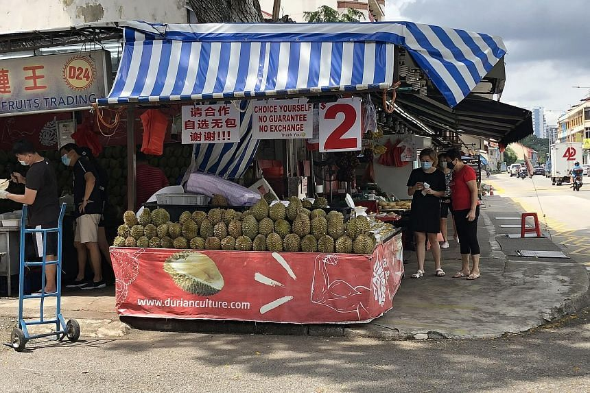 Stalls like Durian Culture in Sims Avenue no longer let buyers eat on their premises, which may lead to a drop in the number of customers.