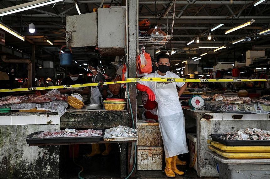 A vendor waiting for customers at a market, amid the movement control order due to the Covid-19 outbreak, in Kuala Lumpur in March. Senior Minister Ismail Sabri Yaakob said open markets, morning markets, night markets and bazaars can resume operation