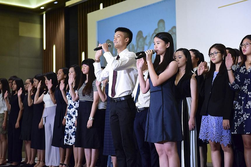 The Public Service Commission's Scholarships Award Ceremony last year. The PSC as well as major companies including OCBC Bank say that they will continue to consider candidates for the same number of scholarships as previous years.