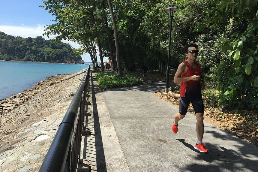 Above: Avid runner Siti Aishah completed over 7,000 lateral ski jumps as part of Spartan's virtual race last weekend. Left: Vincent Lim jogging along his favourite route in Labrador Park, for a virtual run organised by 42Race.