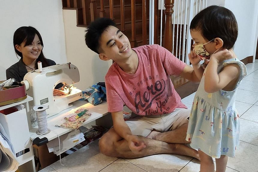 Ms Tracy Tan with her husband Mr Lim Hao and daughter Mira. The couple, who run a handyman company, started an initiative to sew and distribute hundreds of child-size masks to needy families.