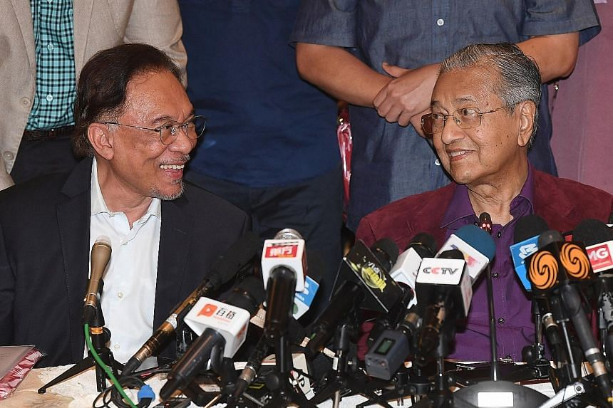 Datuk Seri Anwar Ibrahim with Tun Dr Mahathir Mohamad in a February photo. It is an open secret that both men believe they should be prime minister should the Muhyiddin administration fall, although publicly, neither is committing either way. Dr Maha