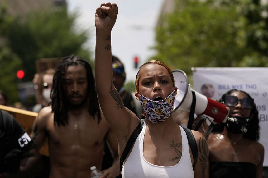 Demonstrators protest against police brutality and racism on June 6, 2020 in Washington, DC.