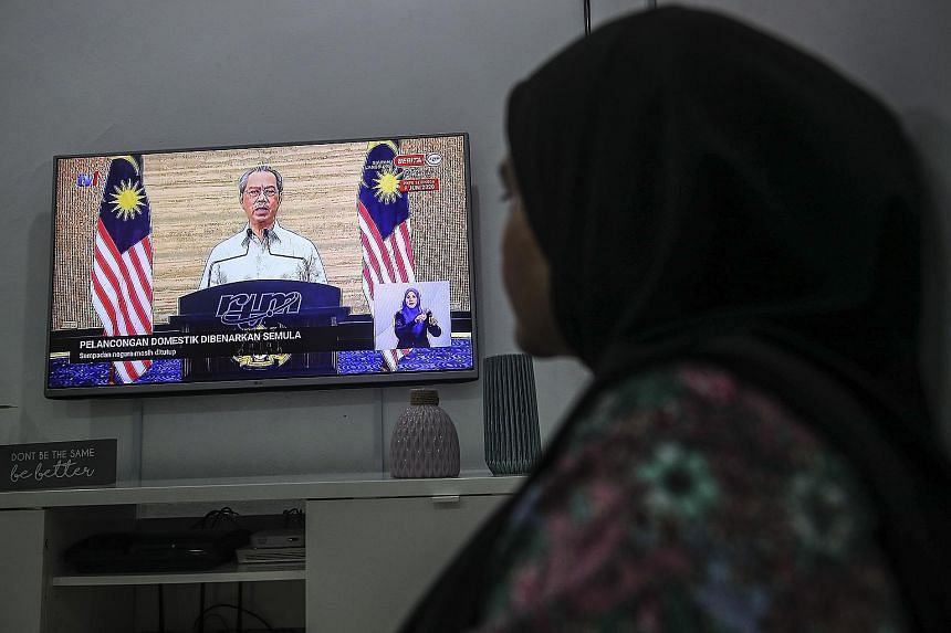 """Malaysian Prime Minister Muhyiddin Yassin announcing at a nationally televised press conference yesterday that the government would allow domestic travel and small-scale social activities, and reopen schools in stages under the """"recovery movement con"""