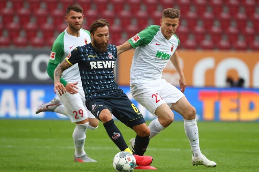 FC Augsburg's Alfred Finnbogason in action with FC Cologne's Marco Hoger (left) on June 7, 2020.