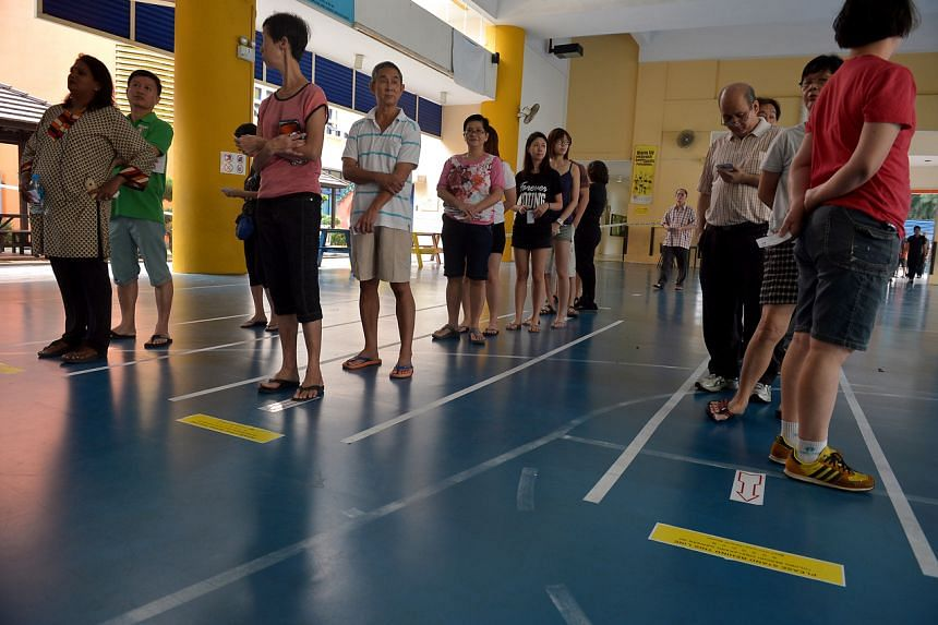 Voters waiting to cast their ballots at Pei Chun Public School on Sept 11, 2015.