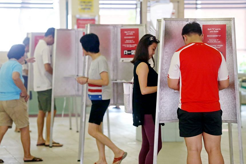 Voters cast their ballots at Jing Shan Primary School on Sept 11, 2015.