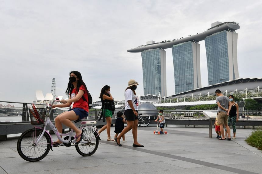 People exercise at the Promontory @ Marina Bay on June 6, 2020.