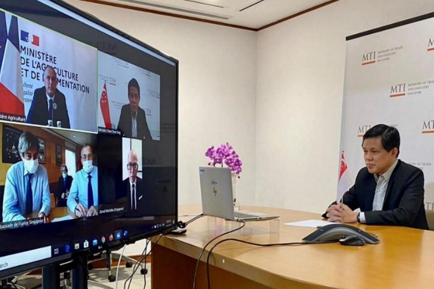 Minister for Trade and Industry Chan Chun Sing at a video conference meeting with Minister of Agriculture and Food of the French Republic Didier Guillaume, accompanied by Singapore Ambassador to France Zainal Mantaha and French Ambassador to Singapor