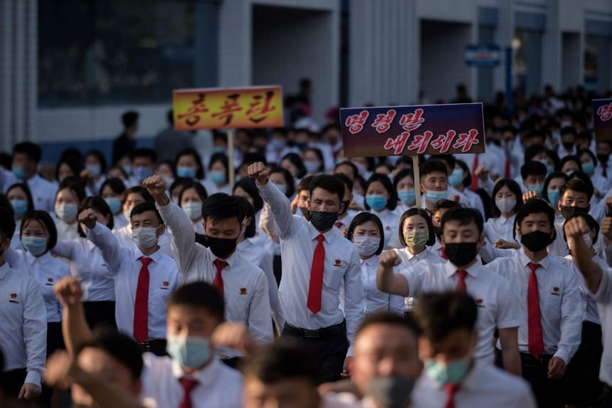 North Korean students take part in a rally denouncing 'defectors from the North' in Pyongyang on June 8, 2020.