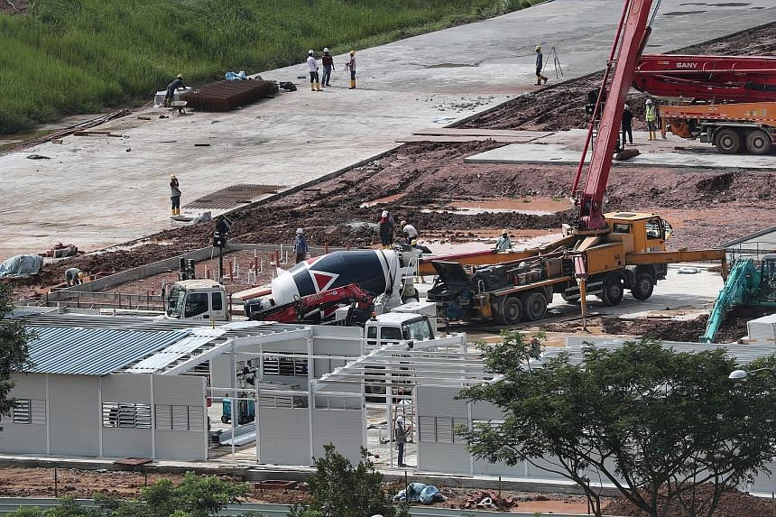 Work in progress at a construction site in Choa Chu Kang Grove last week. The Government will build new workers' dormitories designed to be more resilient against infection risks. ST PHOTO: KELVIN CHNG