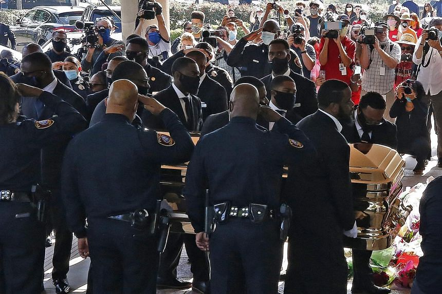 The casket carrying the body of African-American George Floyd being taken into The Fountain of Praise Church in Houston yesterday before a private funeral service. Thousands in his home town of Houston paid their respects at a public viewing of his c
