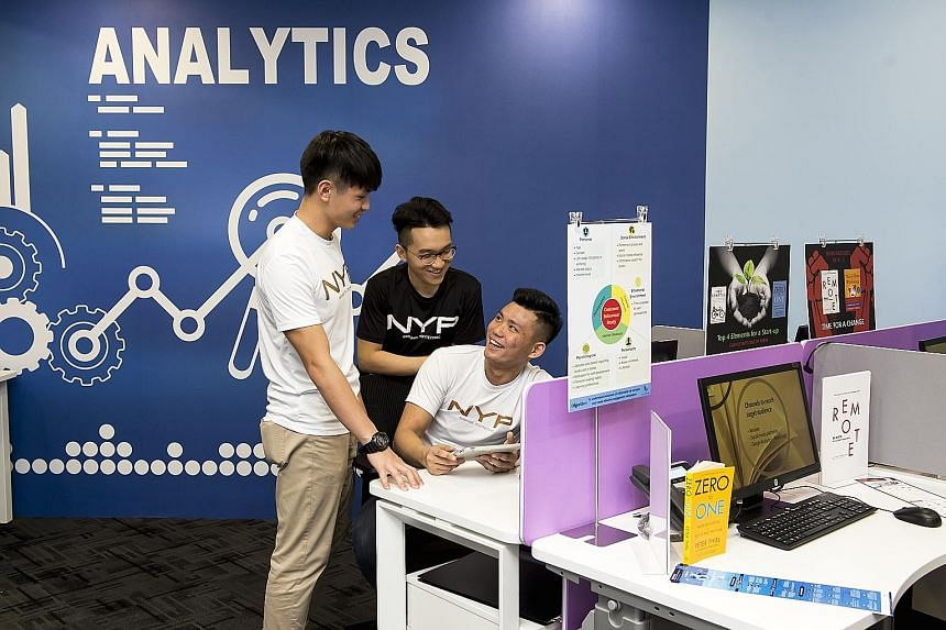 Nanyang Poly students working on a group project last year before the Covid-19 outbreak. Under the new approach, they will take on multi-disciplinary tasks or projects that combine several subjects and skills. PHOTO: NANYANG POLYTECHNIC