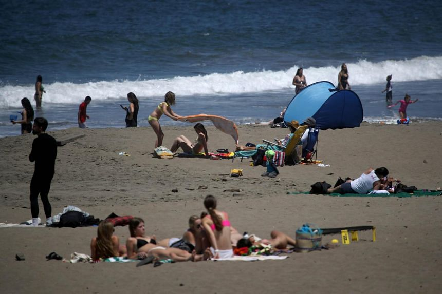 People at Baker Beach on May 26, 2020, in San Francisco, California.