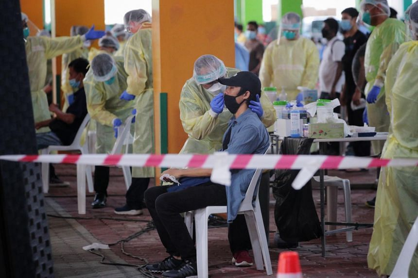 Essential workers being screened for Covid-19 at a regional screening centre at the Float at Marina Bay on June 9, 2020.
