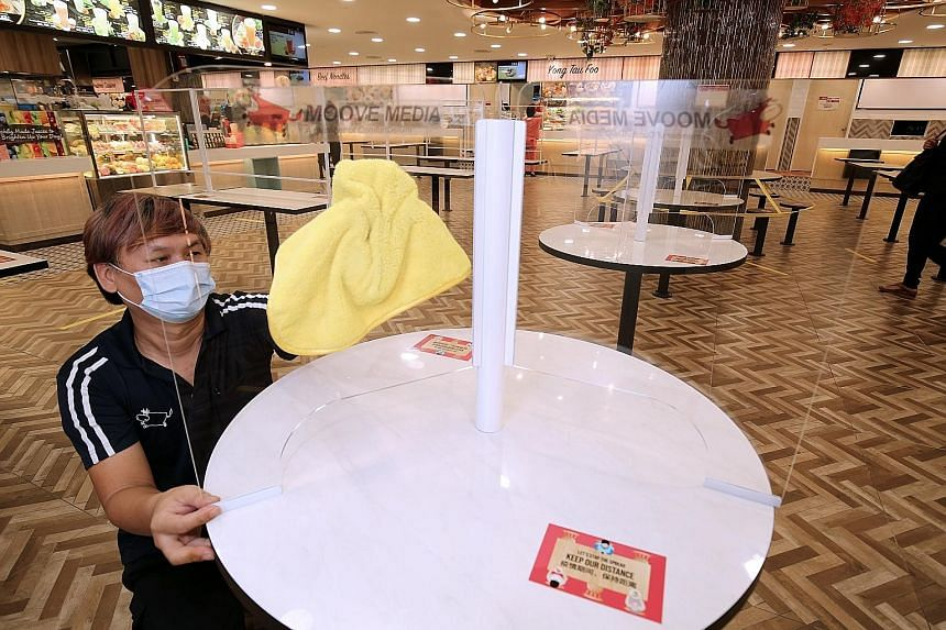In a month-long trial at Thomson Plaza's Koufu foodcourt, 3mm-thick clear acrylic sheets will be installed at 50 tables to separate diners seated across from or next to one another. Moove Media, which is sponsoring the trial, says the shields are sim