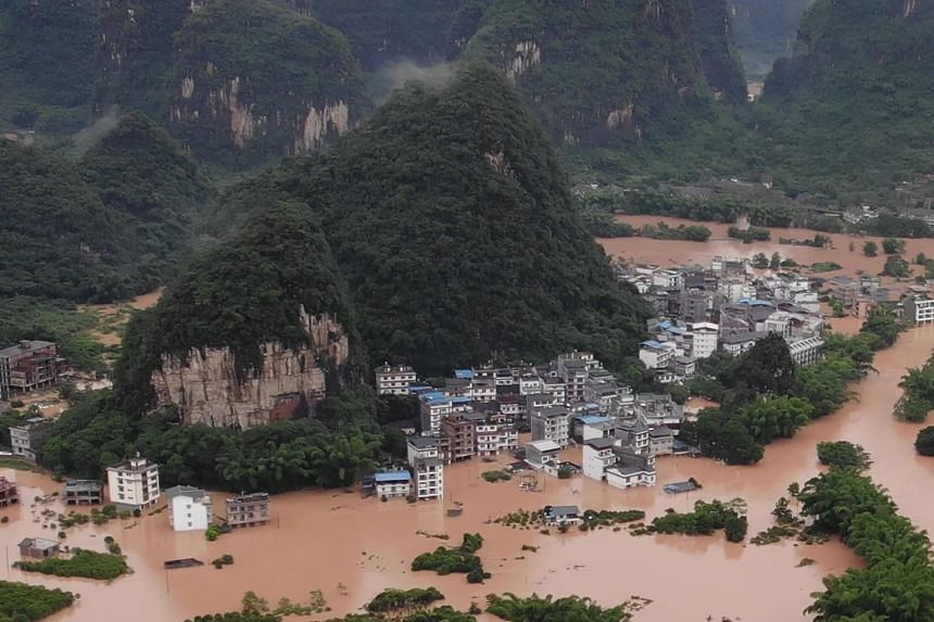Submerged streets and inundated buildings are seen after heavy rain caused flooding in Yangshuo, on June 7, 2020.