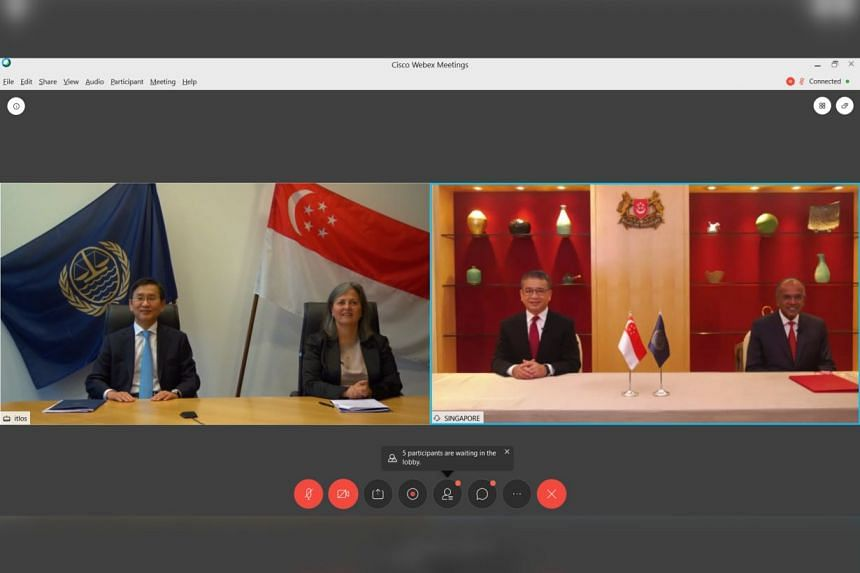 Itlos president Jin-Hyun Paik, registrar of the tribunal Ximena Hinrichs Oyarce, Senior Minister of State for Law and Health Edwin Tong, and Minister for Law and Home Affairs K. Shanmugam after a virtual signing ceremony.