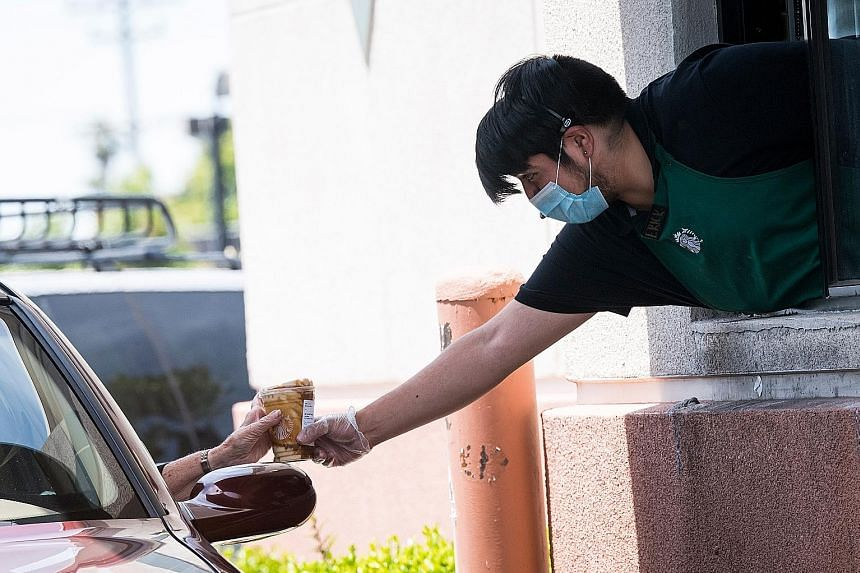 A Starbucks drive-through station in California. The firm plans to accelerate the roll-out of its pickup store concept, with smaller-format locations without customer seating. It says the pandemic has forced it to rethink its central concept of being