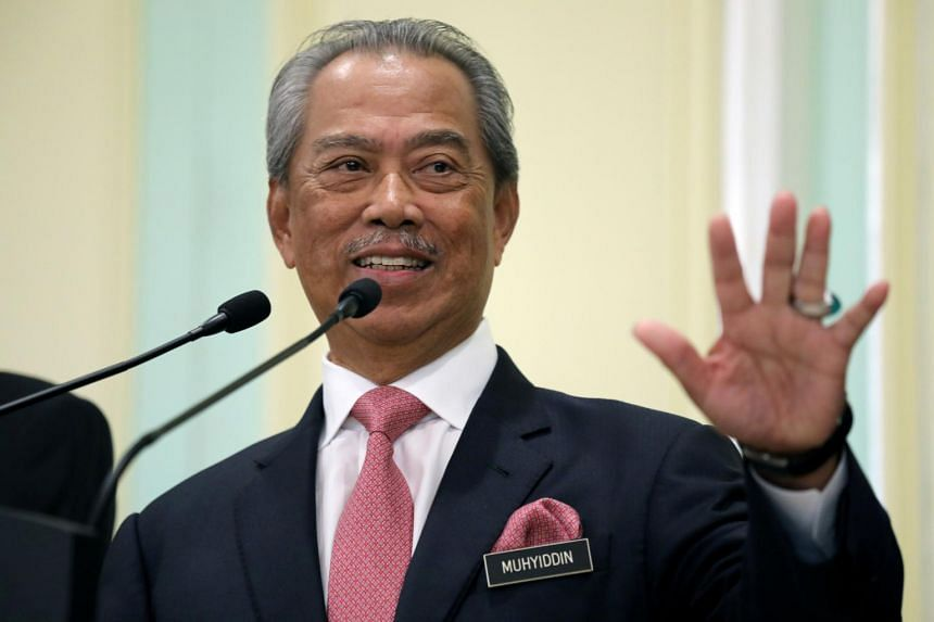 Malaysia's Prime Minister Muhyiddin Yassin speaks during a news conference in Putrajaya, Malaysia, on March 11, 2020.