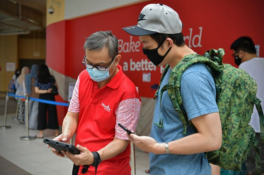John Lui taking down details of a customer at Redman at Heartbeat@Bedok.