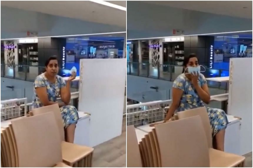 The woman was filmed taunting a man while demanding he remove his mask to speak to her.