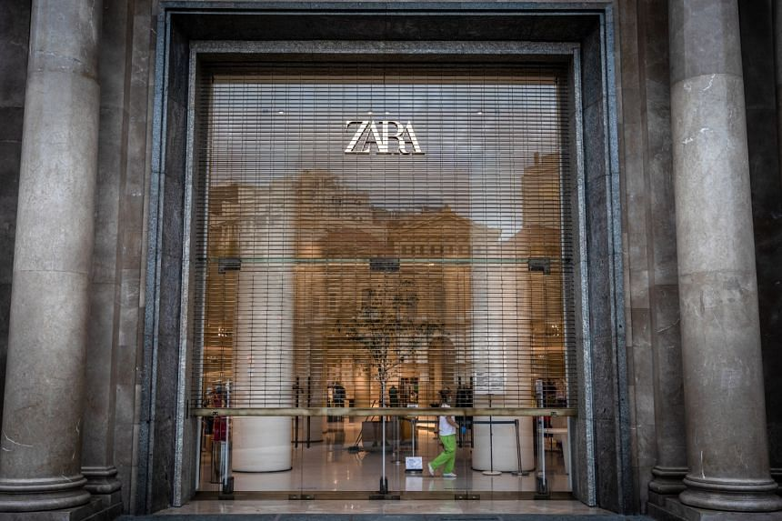 A Zara store in Barcelona, Spain, getting ready to open for the day. Inditex, which owns Zara and other brands like Pull&Bear, Oysho and Stradivarius, is planning to close as many as 1,200 stores worldwide.