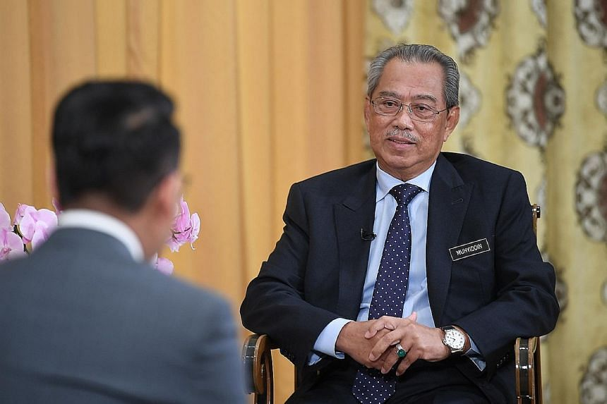 Bersatu sources told The Straits Times that party president and Malaysian Prime Minister Muhyiddin Yassin, seen here giving an interview to Malaysian media in his office in April, made his intentions to call snap elections clear at the Bersatu suprem