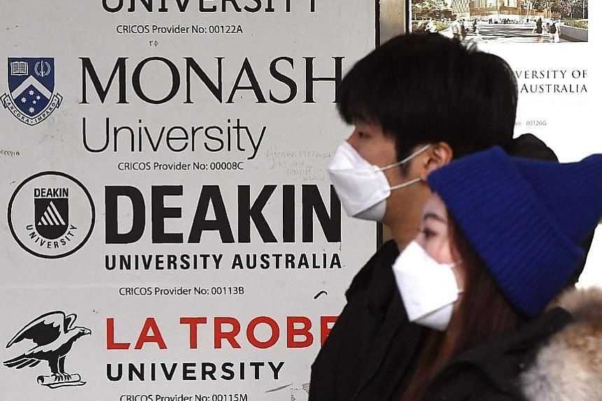 Signage in Melbourne for Australian universities. International students may soon be let back into the country. PHOTO: AGENCE FRANCE-PRESSE