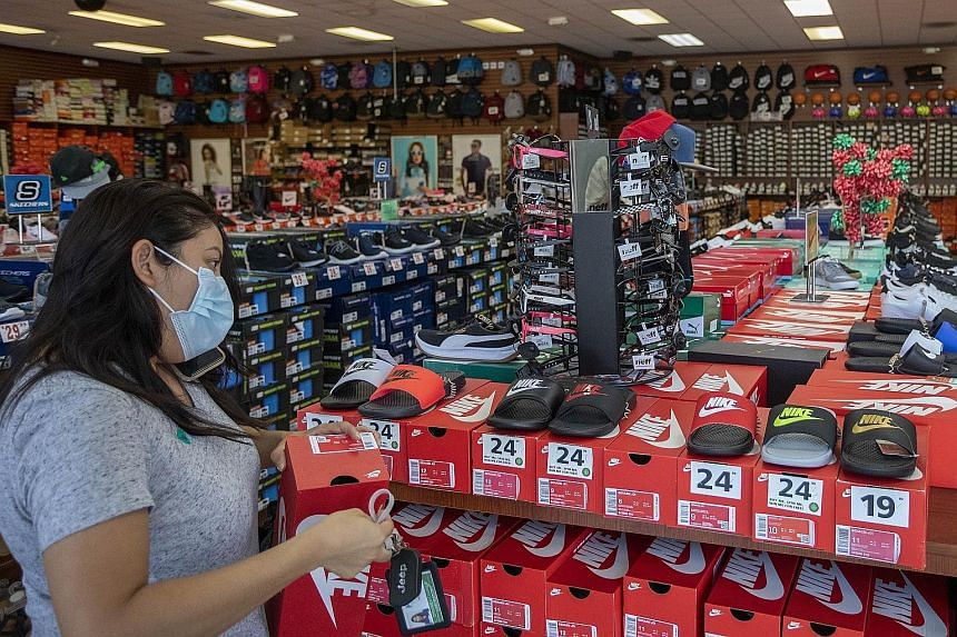 A shopper at a store in California last month, after stores were allowed to reopen with restrictions. Whether people see unexpected savings built up during coronavirus lockdowns as a windfall or a buffer against future uncertainties is likely to dete