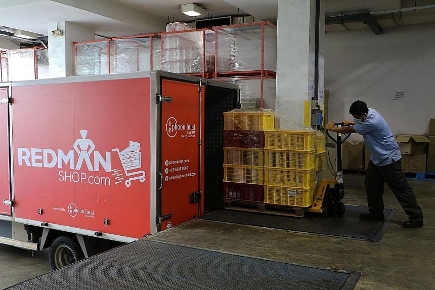 Baking ingredients supplier Phoon Huat's trucks make several hundred deliveries a day. The bulk of its business used to be supplying food businesses. Now, chief executive officer Shuichi Sato says it is half business to business and half retail.