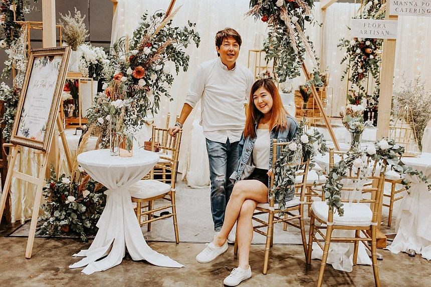 MS BELICIA TAN, co-founder of wedding florist and stylist Flora Artisan, who is prepared for her company to take on more small projects in the future, in a bid to try to make the same profit. With her in the photo is Flora Artisan creative director Jonath